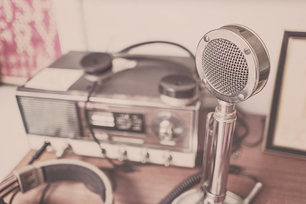 radio studio equipment, including a microphone | image source: Pexels.com