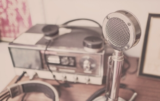 radio studio equipment, including a microphone | image source: Pexels.com