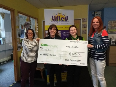Lifted's Sue, Christine, and Emma receiving the £200 cheque from Asda Wythenshawe's Community Champion, Rebecca