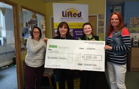 Lifted's Sue, Christine, and Emma receiving the £200 cheque from Asda Wythenshawe's Community Champion