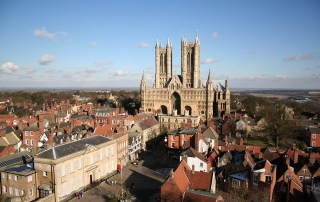 A view from across Castle Square and Exchequergate to the west front of the Cathedral from the top of the Castle Observatory Tower in Lincoln