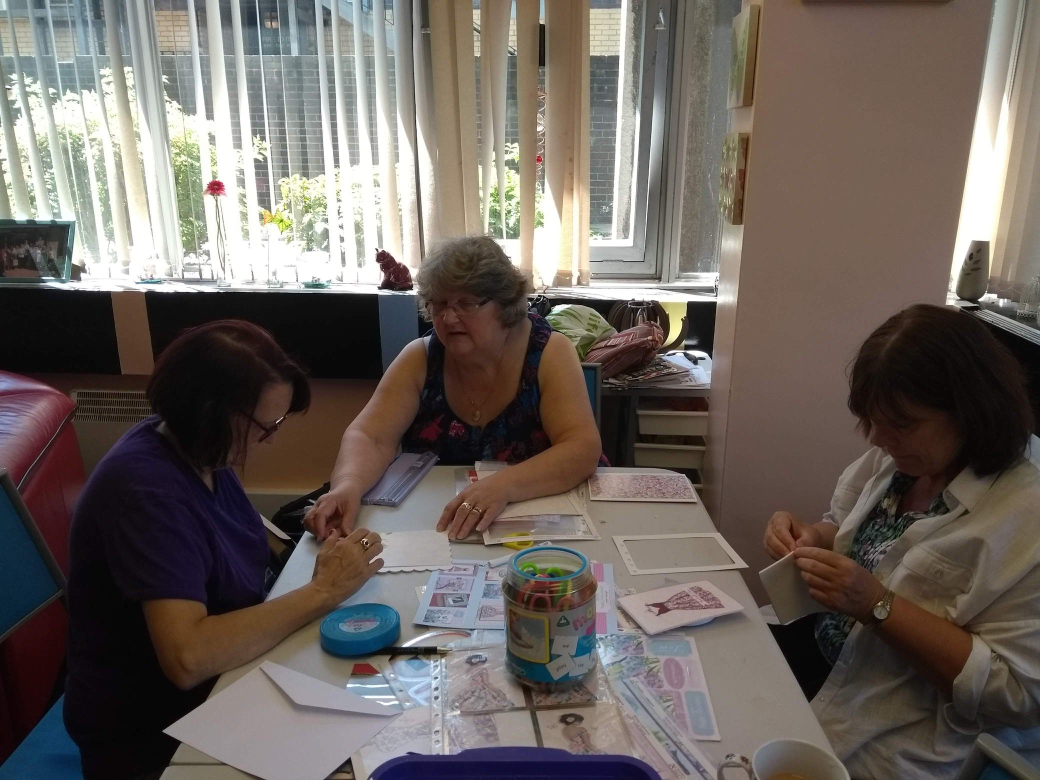Sue, Karen, and Christine making handmade cards during Crafts Day at Lifted Carers' Centre