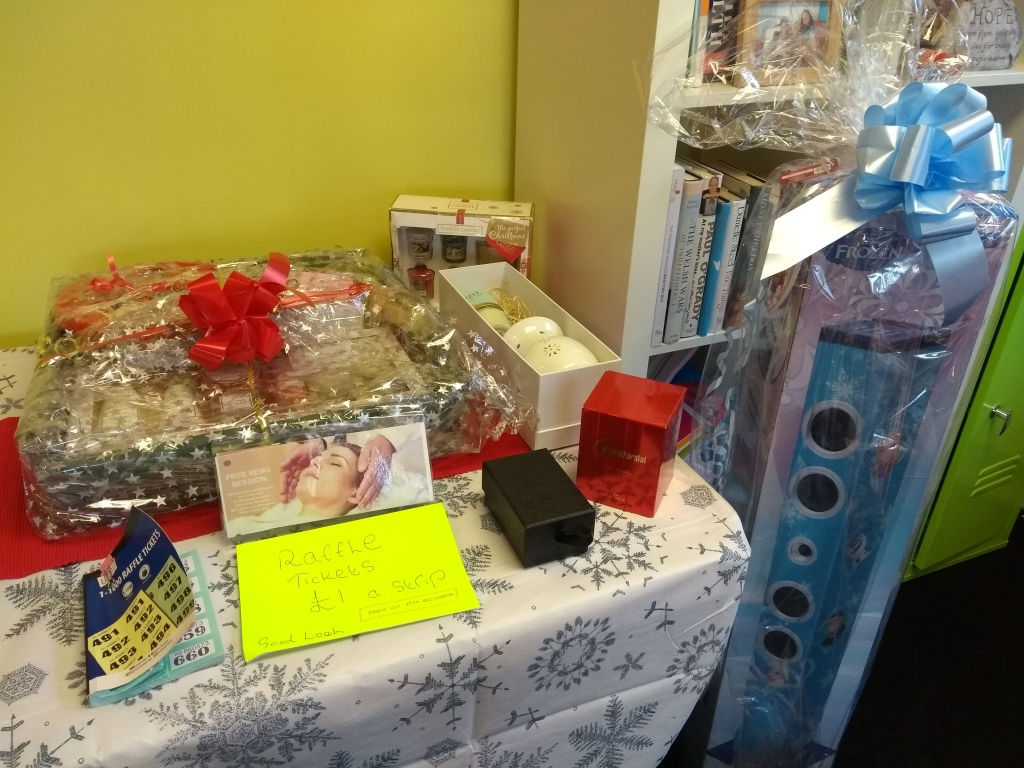 Prizes for Lifted's Christmas Raffle 2018 : Grand prize containing a beauty/ pampering set, bottle of buck's fizz, mug, and box of Celebrations chocolates; Darceys lights; Yankee candles