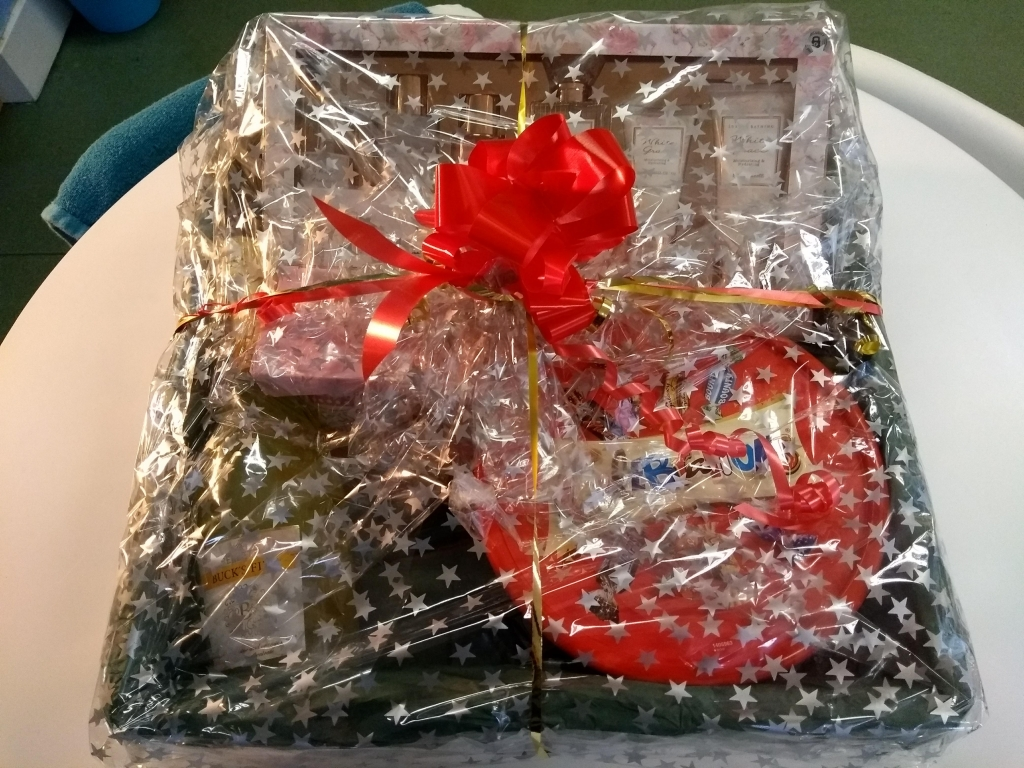 Grand prize for Lifted's Christmas Raffle 2018 : a package containing a beauty/ pampering set, bottle of buck's fizz, mug, and box of Celebrations chocolates