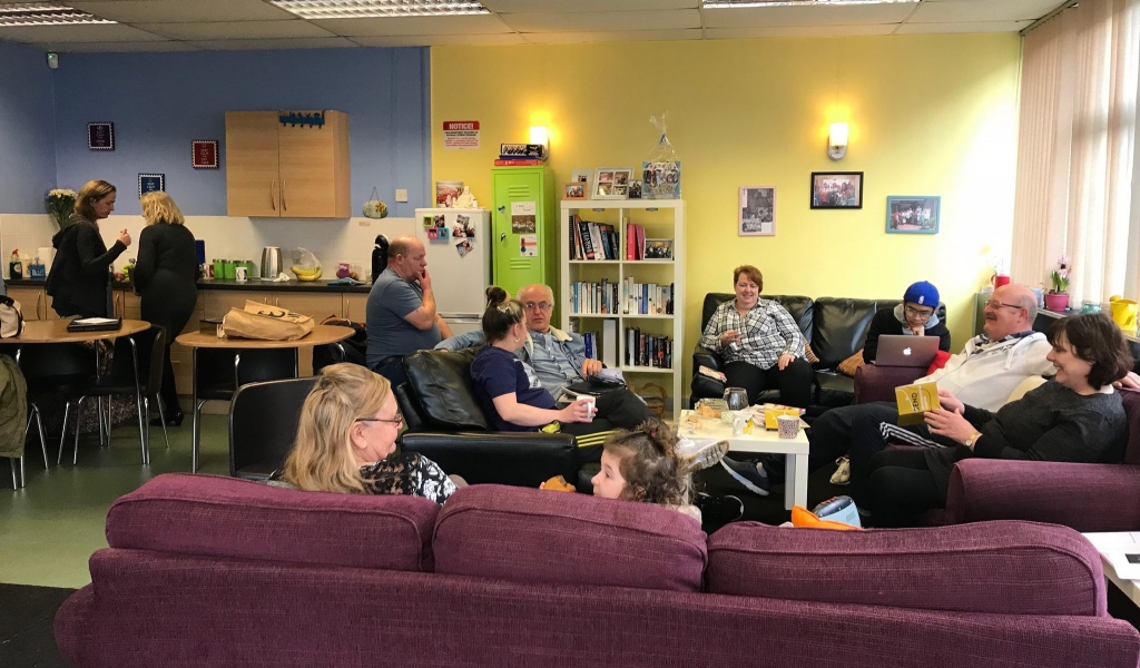 A group of parent-carers chatting and having a good time in Lifted carers' centre