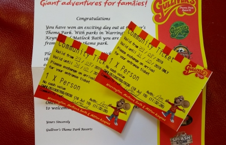 Two community tickets for Gulliver's theme parks and resorts, with the sponsorship letter in the background