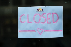 A sign saying 'Closed' with a drawing of a heart and Lifted's logo | Photo Credit: Markus Spiske on Unsplash